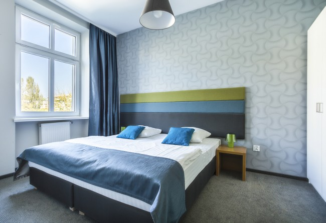Big Twin Bed In Blue Hotel Apartment