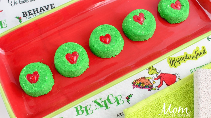 Grinch-Inspired Crafts like these DIY Grinch Bath Bombs are perfect for the coming holidays!