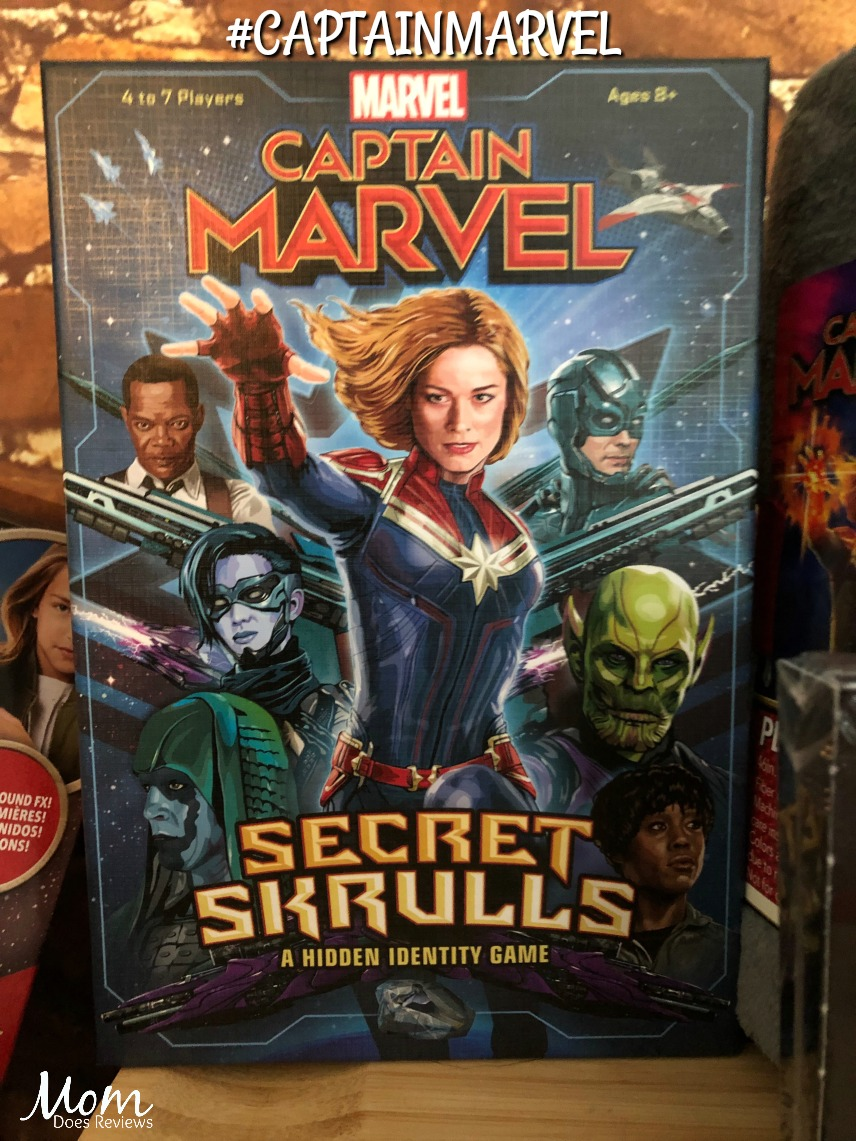 Captain Marvel: Secret Skrulls is a hidden identity game where players take on the roles of their favorite Marvel characters, including Captain Marvel herself, to defend Earth in an intergalactic war against shape-shifting Skrulls in disguise. Players must decide whom to trust, defend their alliance, and restore the planet's virtue. Based on the popular game mechanic of BANG!