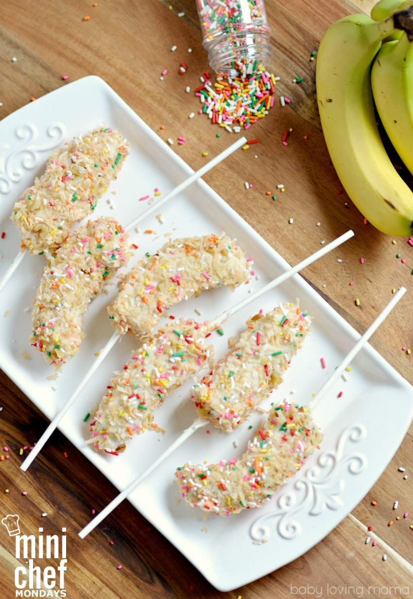 Yogurt Dipped Frozen Banana on a Stick with Toasted Coconut