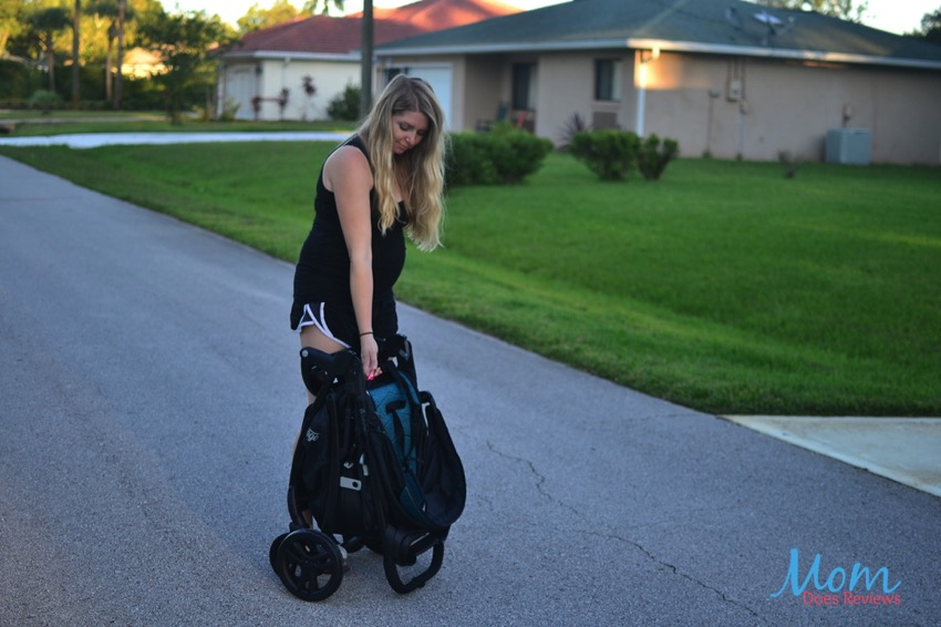 Folding Baby Trend Tango Travel System with one hand