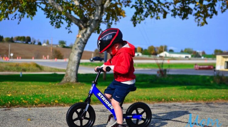 boy on strider bike