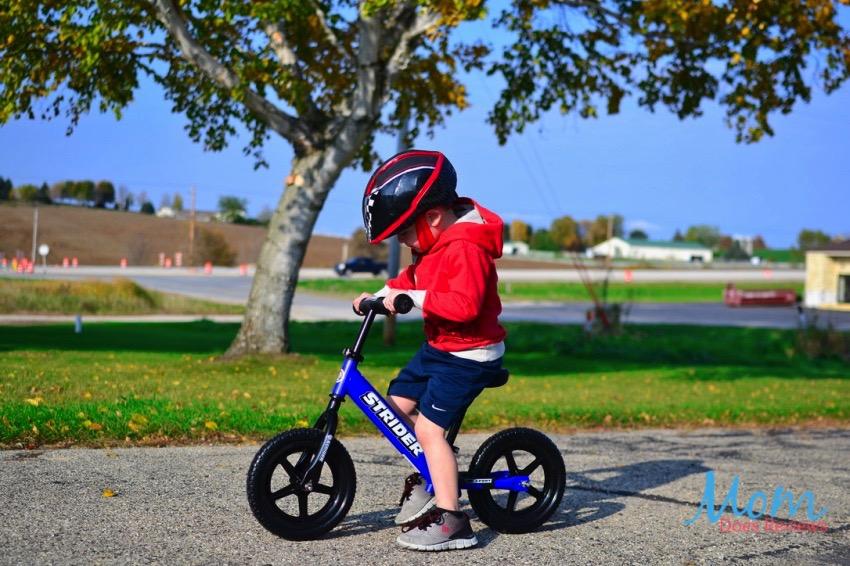 boy on strider bike